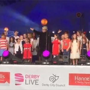 Combined Darley Abbey Schools Choir signing in front of 25,000+ crowd